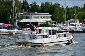 DOLGOPRUDNY, MOSCOW REGION, RUSSIA - JULY 4, 2014: People resting on the trip boat against yacht clu