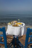 pic of ouzo  - greek food outdoors and the sea on a sunny day - JPG