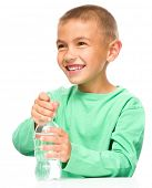 Cheerful little boy with plastic bottle of water, isolated over white
