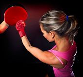Young woman making a hard punch during training