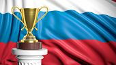 Golden trophy with Russian flag in background