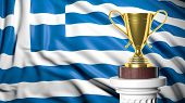 Golden trophy with Greece flag in background