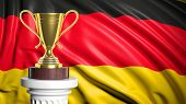 Golden trophy with Germany flag in background