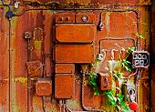 stock photo of contactor  - Old electrical panel on a iron wall - JPG