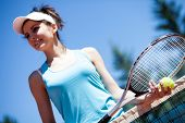 foto of youg  - Youg pretty girl playing tennis on cort - JPG