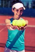 stock photo of youg  - Youg pretty girl playing tennis on cort - JPG