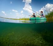 Split shot of two fishermen in the boat in reed's thicket and underwater view of the bottom