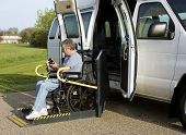 picture of disable  - disabled man using the remote control on a wheelchair lift van - JPG