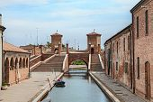 stock photo of ferrara  - the antique bridge Trepponti, a famous five-way bridge in Comacchio, Ferrara, Italy
