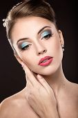 Beautiful girl with bright makeup and evening hairstyle.