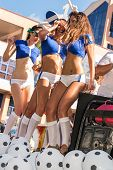 Victoria, Seychelles - April 26, 2014: Group Of Italian Female Football Fans At The Carnival Interna