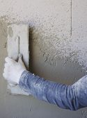 Worker performs internal plaster