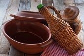 Old Crocks With Rattan Bottle