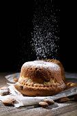 Tasty cakes on table on black background