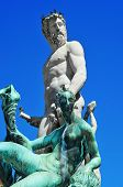 detail of Fountain of Neptune located in Piazza della Signoria in Florence, Italy