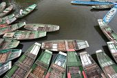 Tam Coc, Ninh Binh, Vietnam. Tour tourist boats in bay near Bich Dong