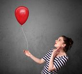 Young woman holding a red balloon drawing