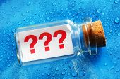 Question mark symbols message in a bottle concept for business confusion, problems and uncertainty