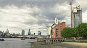 Skyline of City of London with Blackfriars Bridge over River Thames.