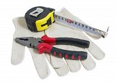 Pliers Red And Black Color, Dirty Leather Gloves And Tape Measure