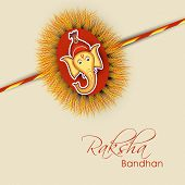 Beautiful rakhi decorated with Hindu mythology Lord Ganesha face on brown background for Happy Raksh