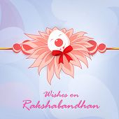 Beautiful pink feather decorated Rakhi on shiny abstract background for Happy Raksha Bandhan celebra