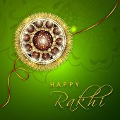 Beautiful rakhi on floral decorated green background for Happy Raksha Bandhan celebrations.