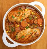 Slow-cooked chicken casserole with onions, carrots and celery and herbs.