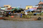 Fruit sellers loading pineapples at the floating market in Can Tho, southern Vietnam