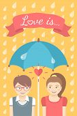 Boy and girl in love under an umbrella in the rain