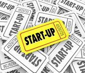 Start-Up word on a golden ticket in a pile of many competitors launching new companies or businesses and only one can be most successful