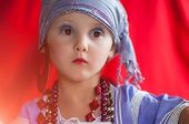 foto of seer  - baby fortune teller with red light looks up - JPG