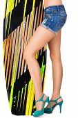 Beautiful woman holding surfing board