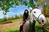 Sensual girl on the horse walk on nature