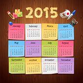 Office Stickers Calendar 2015 calendar on Wooden Background