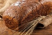 Brown Bread And Ears Of Wheat Closeup