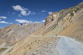 pic of manali-leh road  - Biker On Mountain Road Manali  - JPG