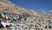 Buddhist Prayer Flags And Stone Pyramids