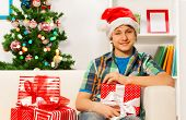 Teen happy young boy with New year presents