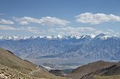 View Of Majestic Himalayan Mountain Summits And Green Valley At Bottom