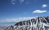 Sharp Snow Covered Mountain Ridge With High Mountain Range Background