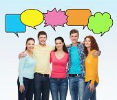 friendship, communication and people concept - group of smiling teenagers over white background with text bubbles
