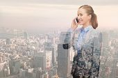 business, people, development and technology concept - smiling young businesswoman over transparent city background