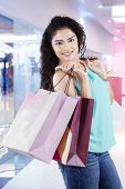 Attractive Indian Girl With Shopping Bags