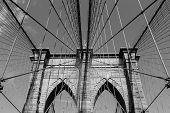 stock photo of brooklyn bridge  - A view of the arches of Brooklyn Bridge in NYC in black and white - JPG