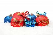 Red,blue Christmas Decoration On Snow In Line