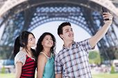 Teenagers Taking Self Pictures In Paris