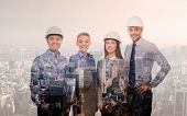 business, architecture, development and people concept - happy team in white hardhats over transparent city background