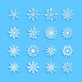 Blue snowflakes and shadow on white background. art