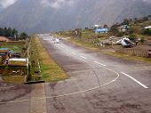 LUKLA, NEPAL - CIRCA OCTOBER 2013: plane on the runway at Lukla airport circa October 2013 in Lukla.